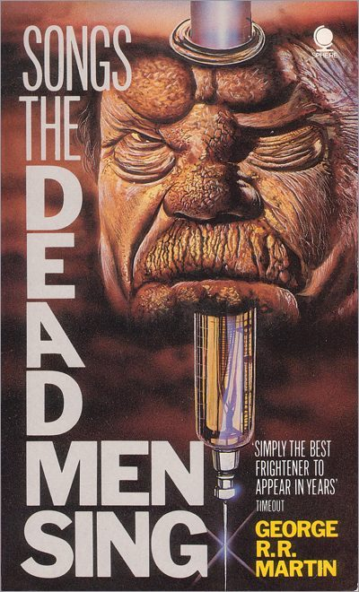 <i>Songs the Dead Men Sing</i>,<br />Sphere Paperback <br />1986 (UK)
