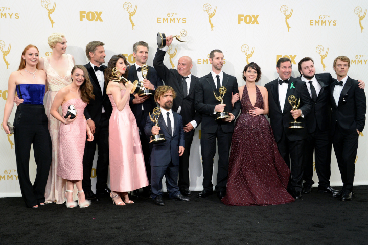 "LOS ANGELES, CA - SEPTEMBER 20:  (L-R) Actors Sophie Turner, Gwendoline Christie, Maisie Williams, Nikolaj Coster-Waldau, Carice van Houten, writer David Benioff, actor Peter Dinklage, Conleth Hill, writer D. B. Weiss, Lena Headey, director David Nutter and actors John Bradley-West and Alfie Allen, winners of Outstanding Drama Series for ""Game of Thrones"", pose in the press room at the 67th Annual Primetime Emmy Awards at Microsoft Theater on September 20, 2015 in Los Angeles, California.  (Photo by Michael Kovac/Getty Images for AXN)"